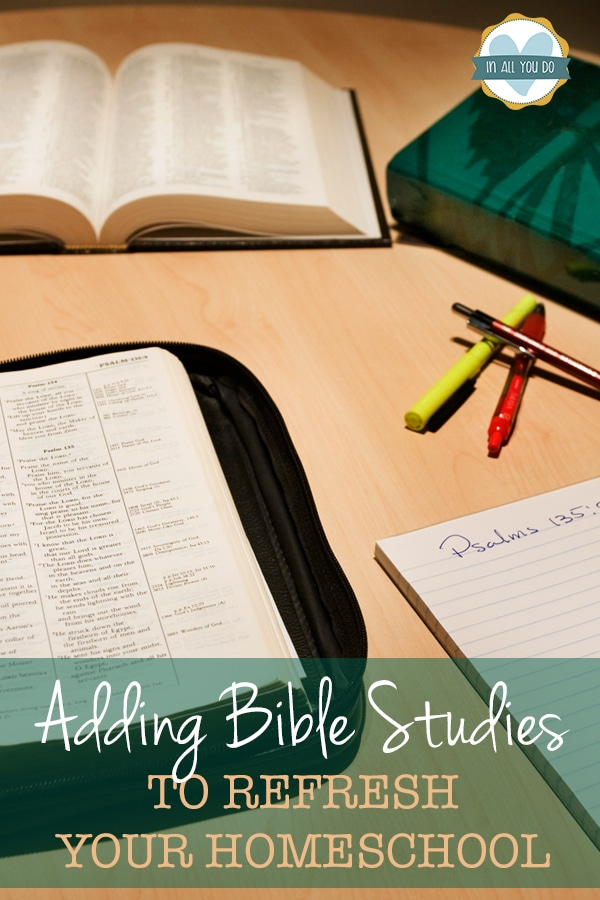 Open Bibles with paper and pens