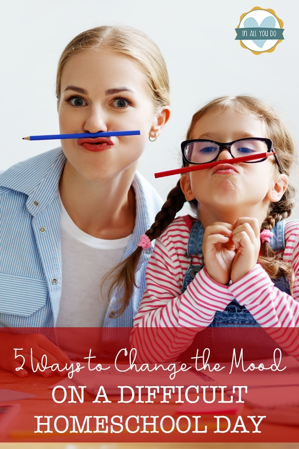 mom and daughter acting silly with pencils as mustaches