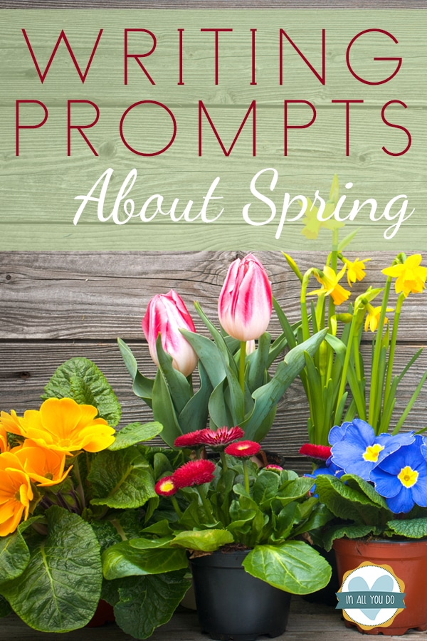 """spring flowers on wood background with overlay """"Writing Prompts About Spring"""""""